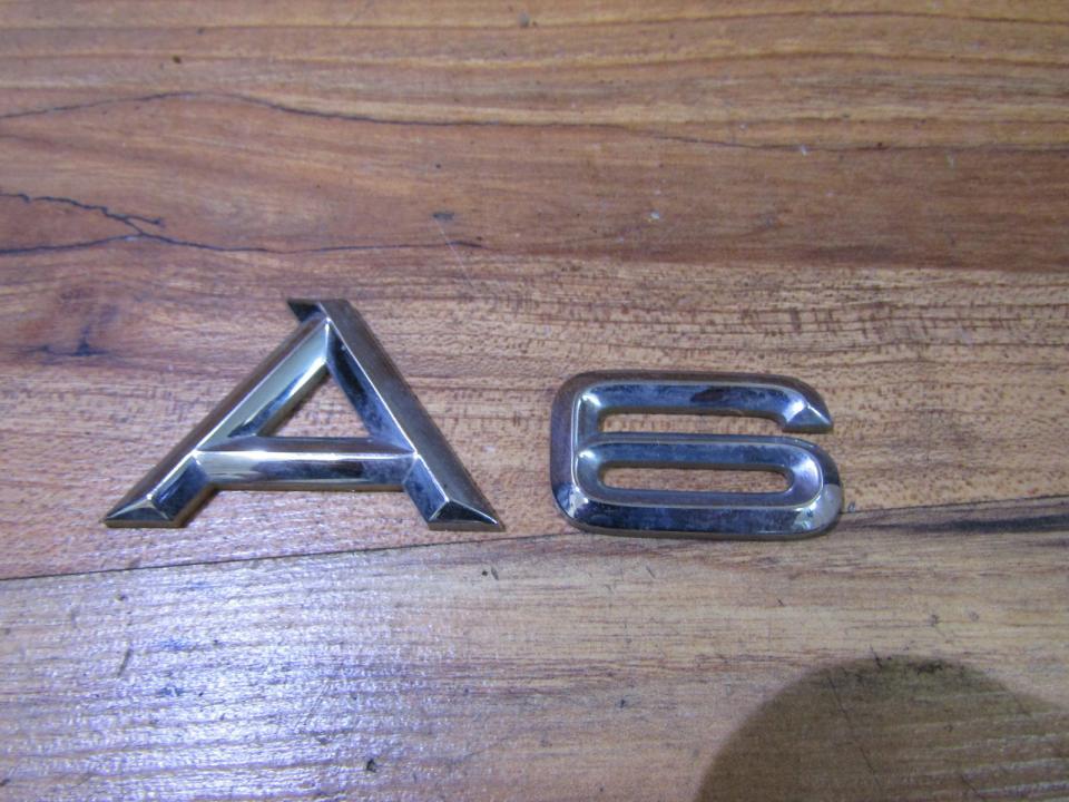 Задние Эмблема Audi A6 1999    2.8
