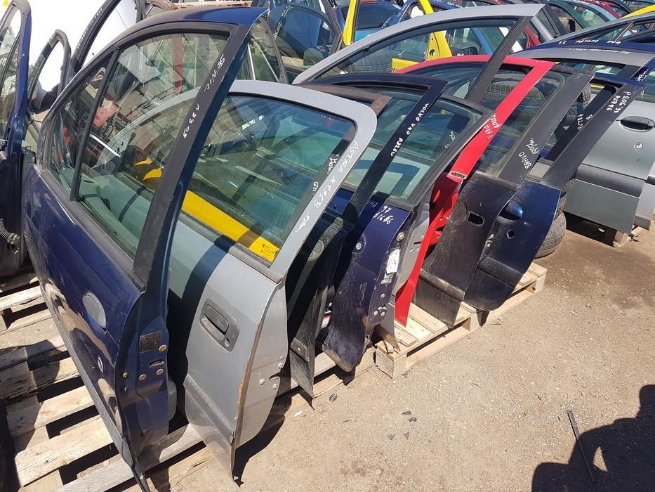 Автомобили Двери - передний левый JUODOS NENUSTATYTA Volvo V40 1998 1.9