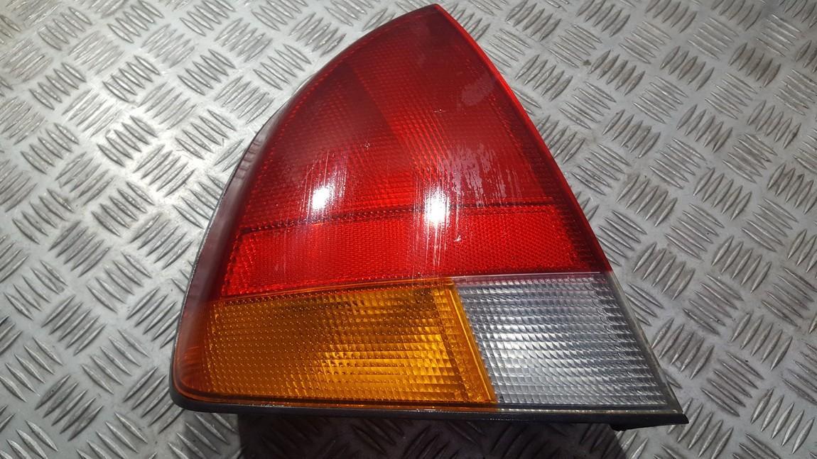 Задние фары левый Mitsubishi Carisma 1998    1.8 MB944543