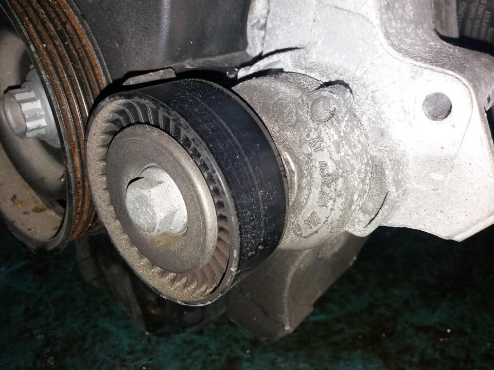 Ролик-натяжитель ручейкового ремня 030145299F   Volkswagen POLO 1993 1.0